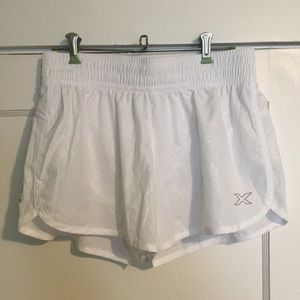 white 2XU athletic shorts